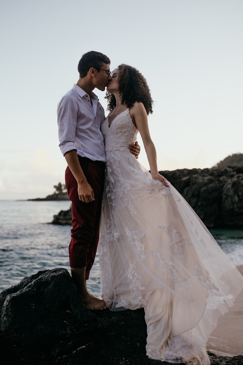 Oahu Wedding Photography, couple kissing next to the ocean