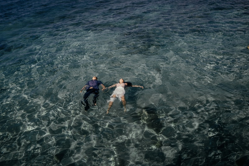 Oahu Couples Photography, couple floating on their backs in the ocean