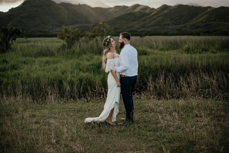Oahu Wedding Photography, couple kissing next to tall grass