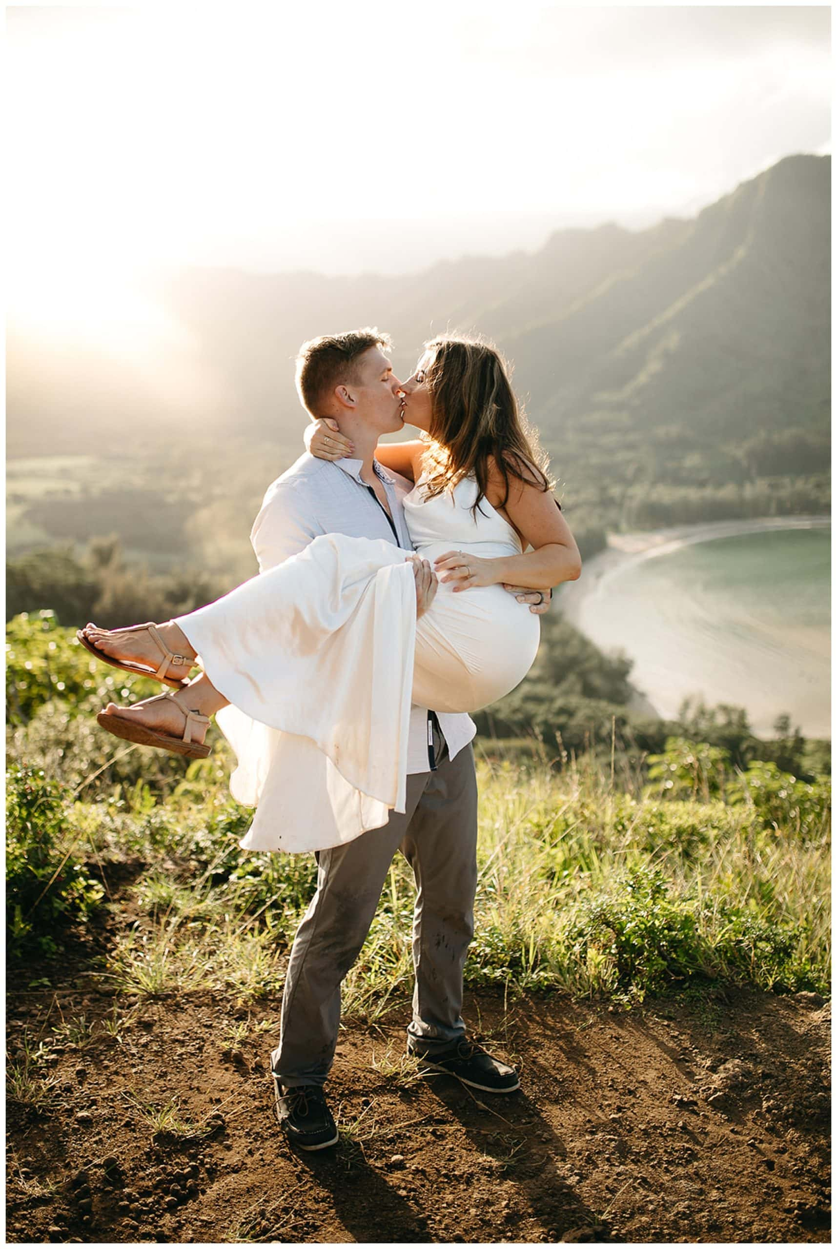 couple dancing and kissing in the mountains of hawaii