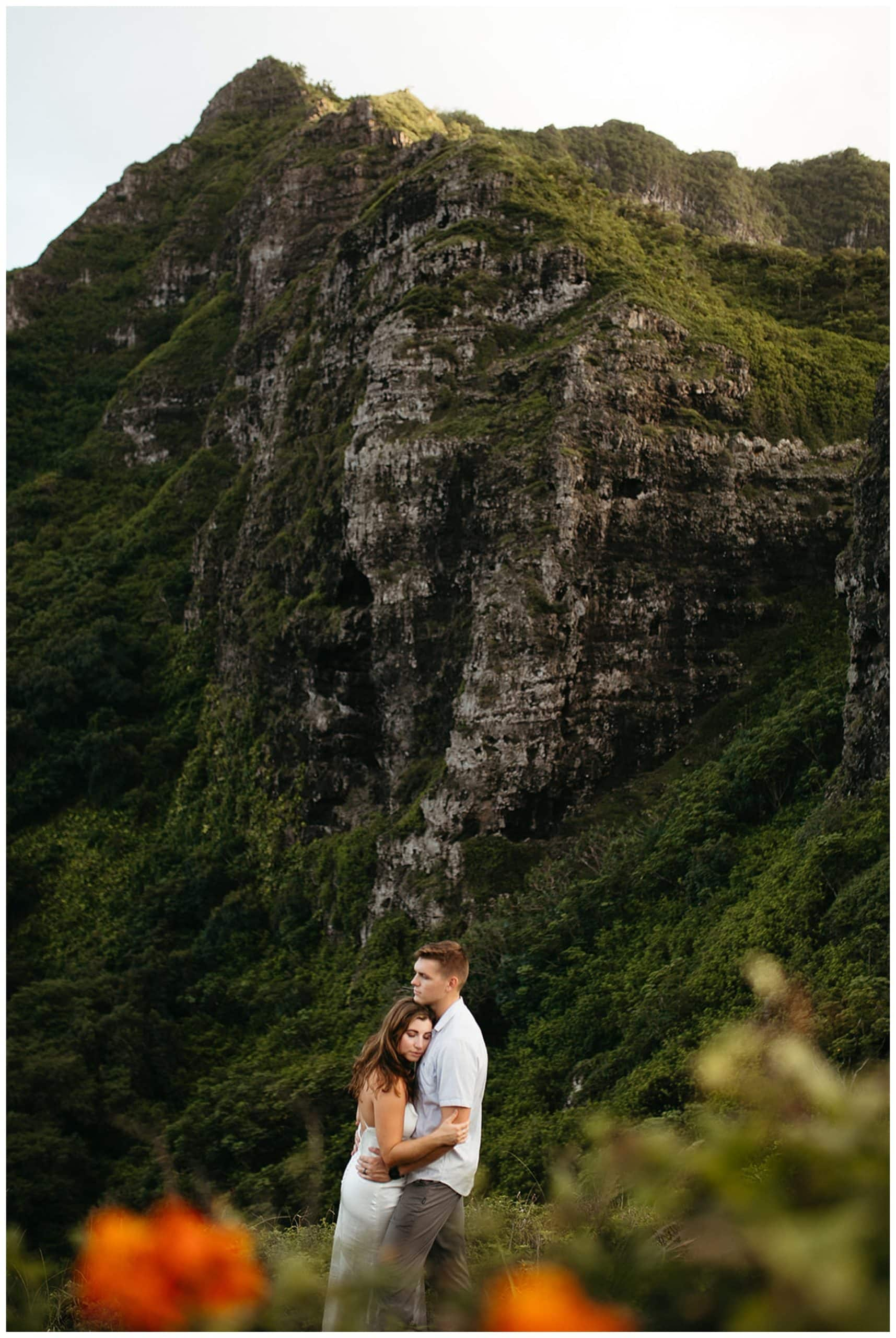 couple hugging in green mountains