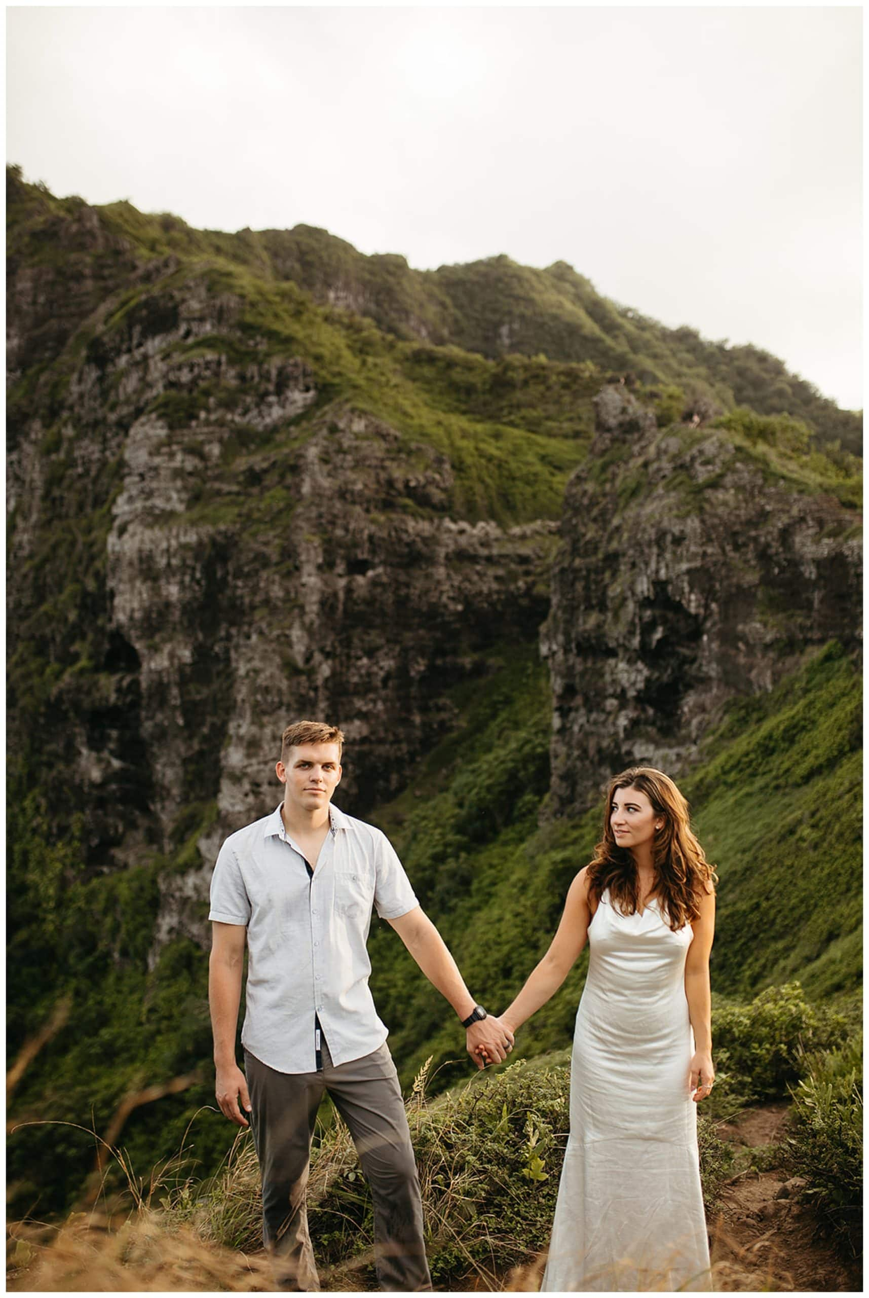 couple standing in oahu mountains