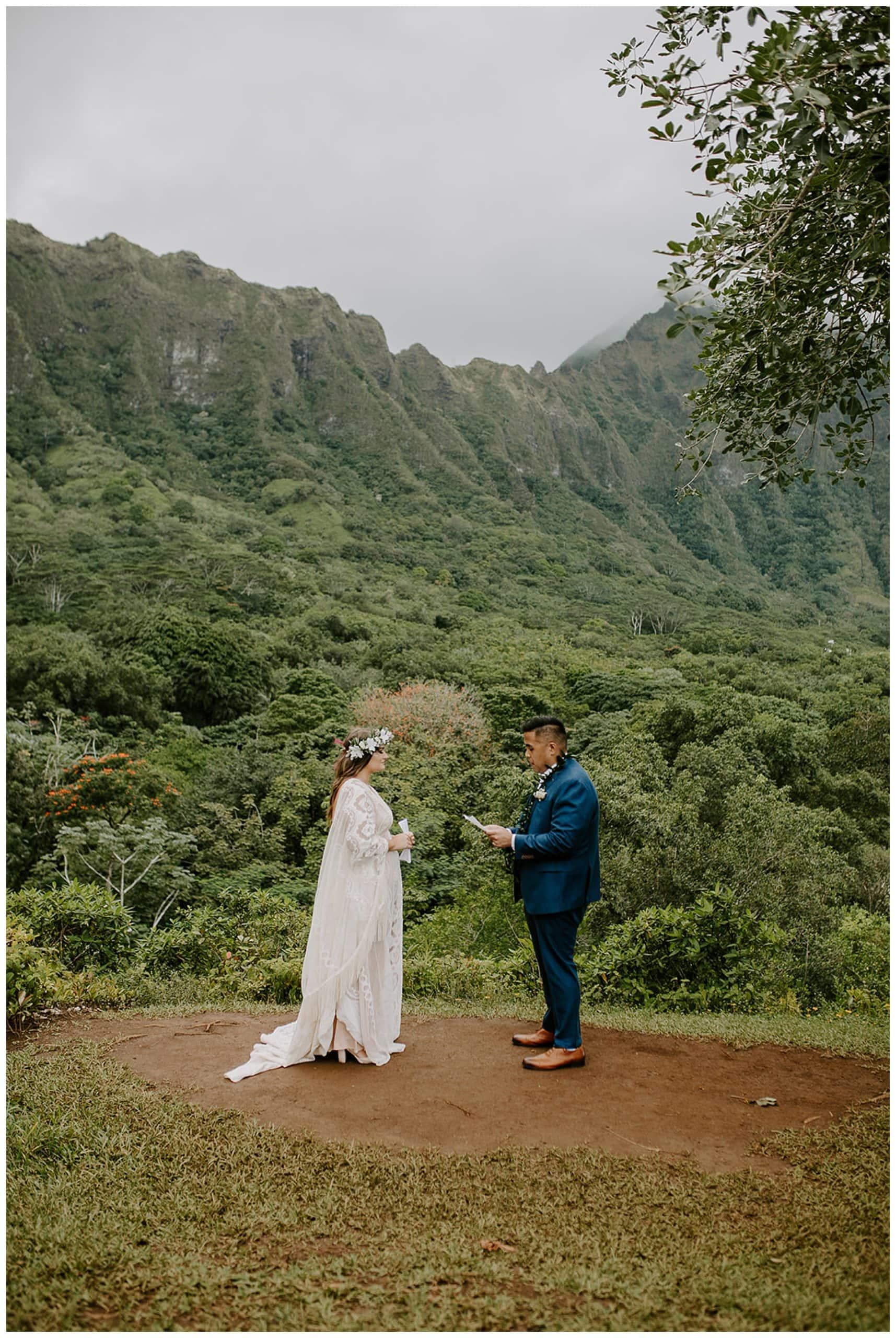 bride and groom reading vows at Ho'omaluhia Botanical Garden
