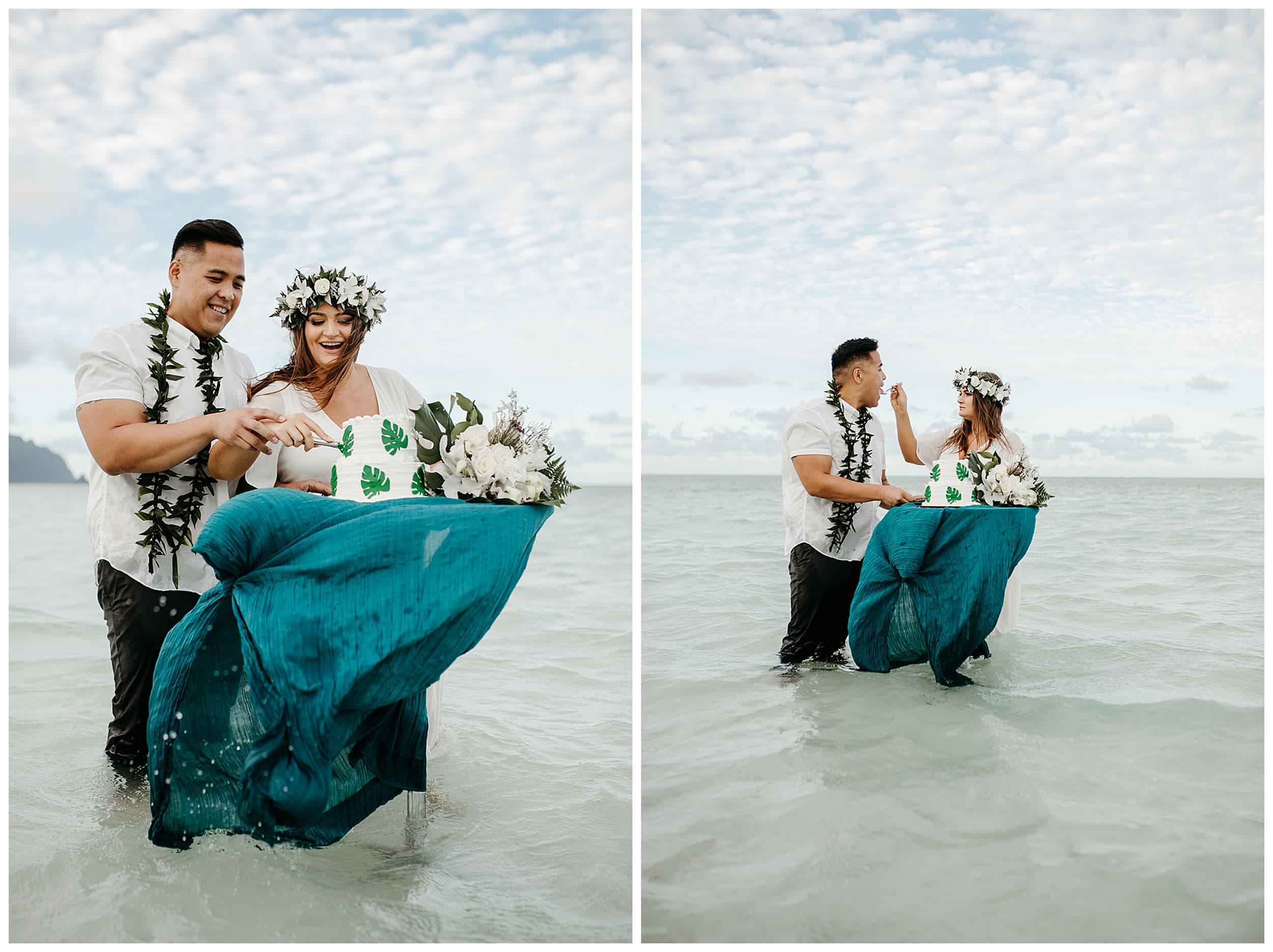 bride and groom cutting cake at Kaneohe Sandbar