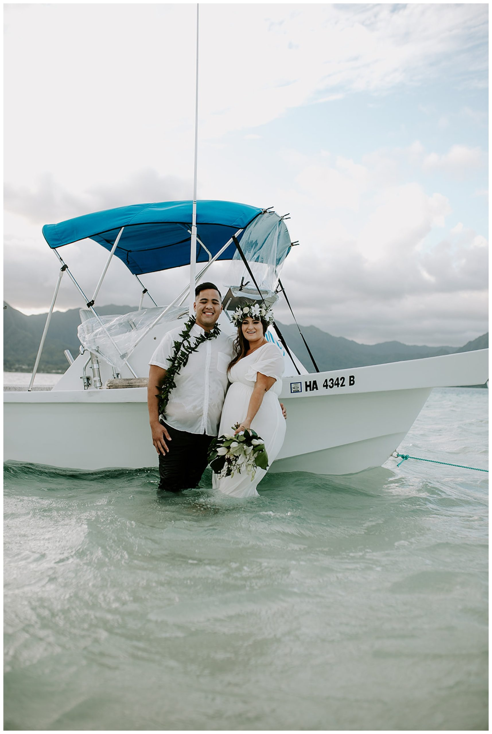 bride and groom on boat in hawaii