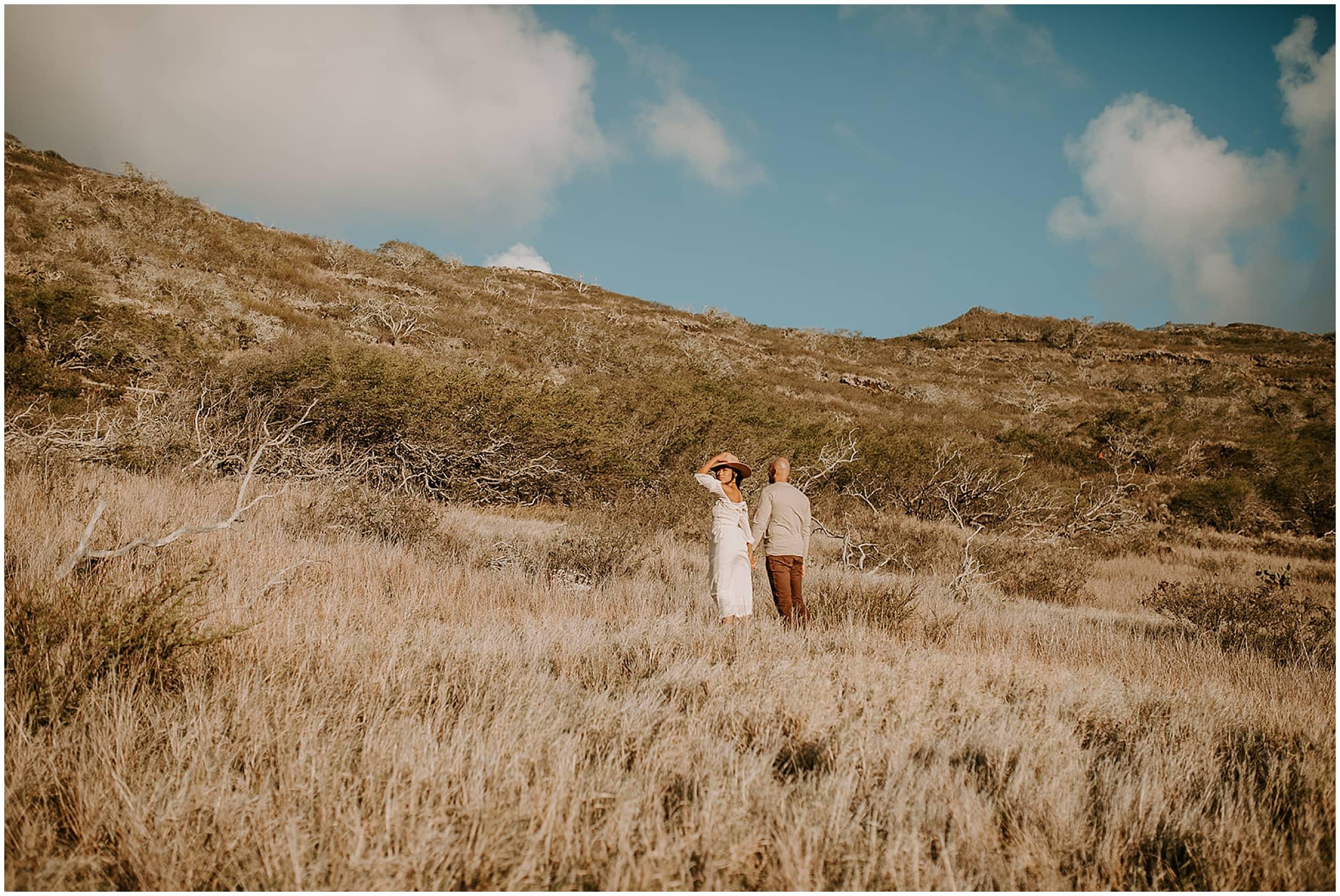 couple standing on hillside