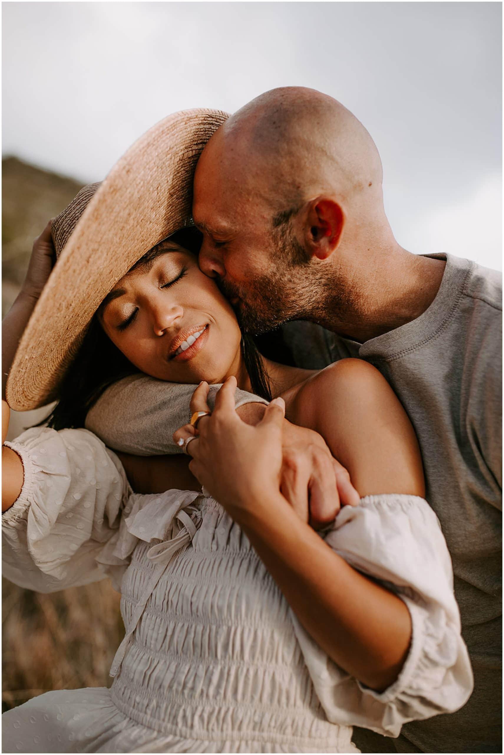 man kissing woman's cheek