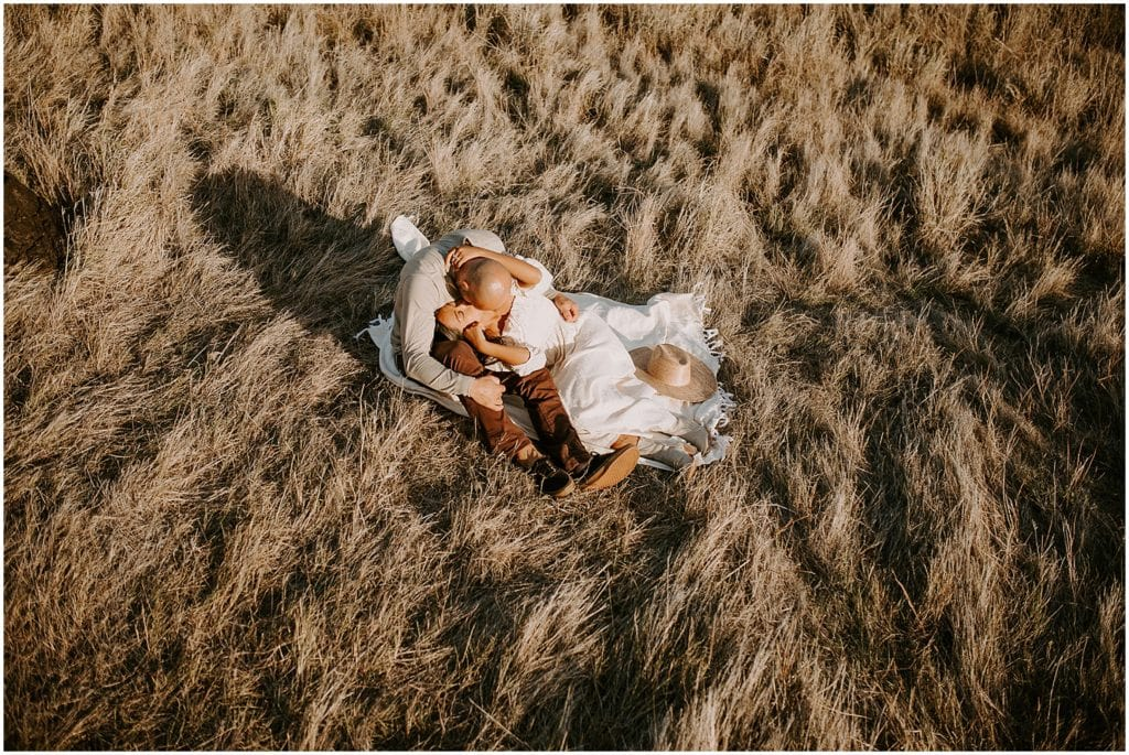 couple laying on hillside