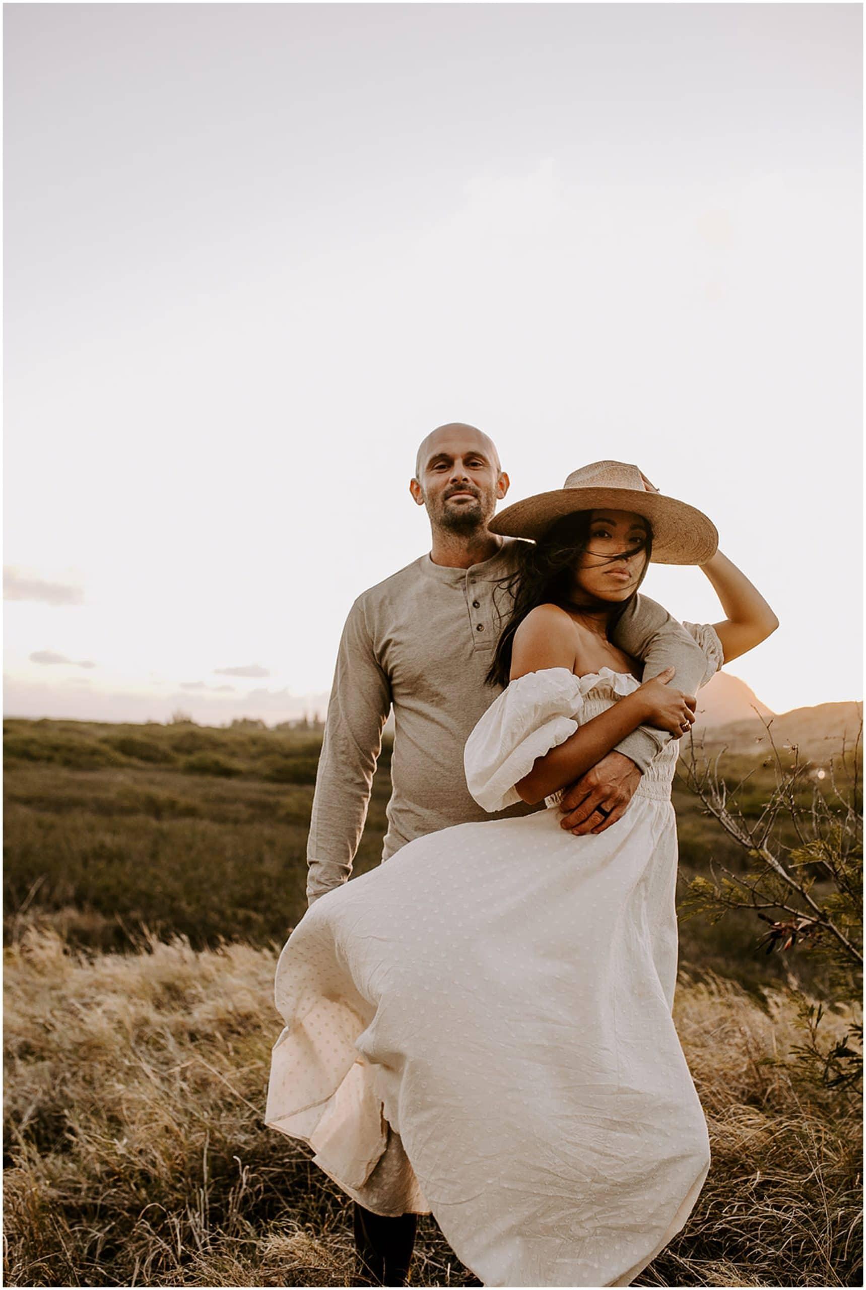 couple posing on mountaintop