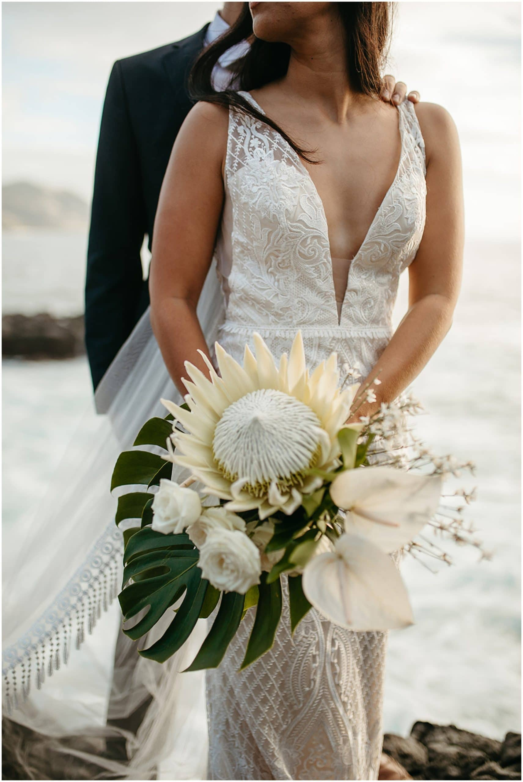 bride holding tropical wedding bouquet