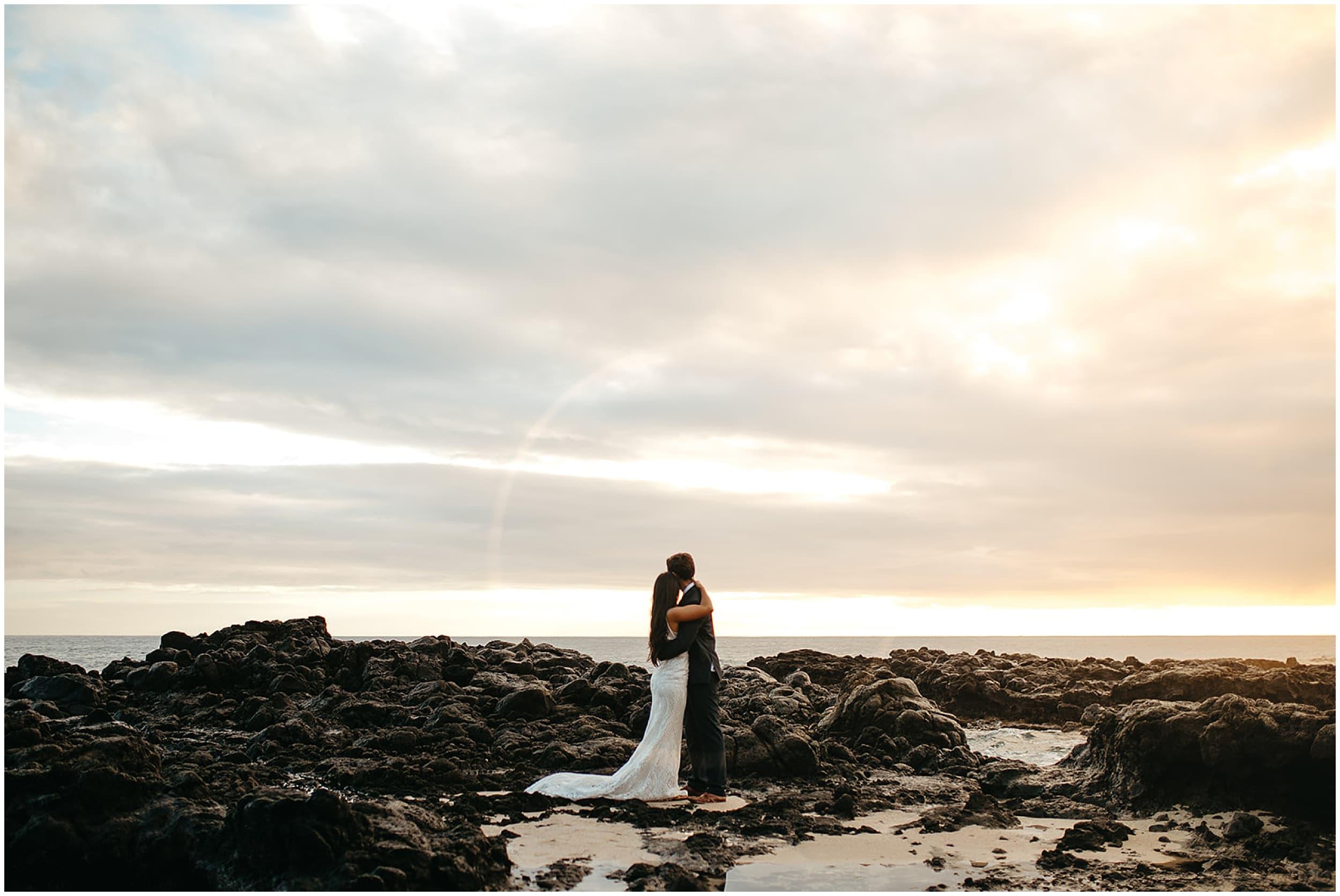 bride and groom watching sunrise
