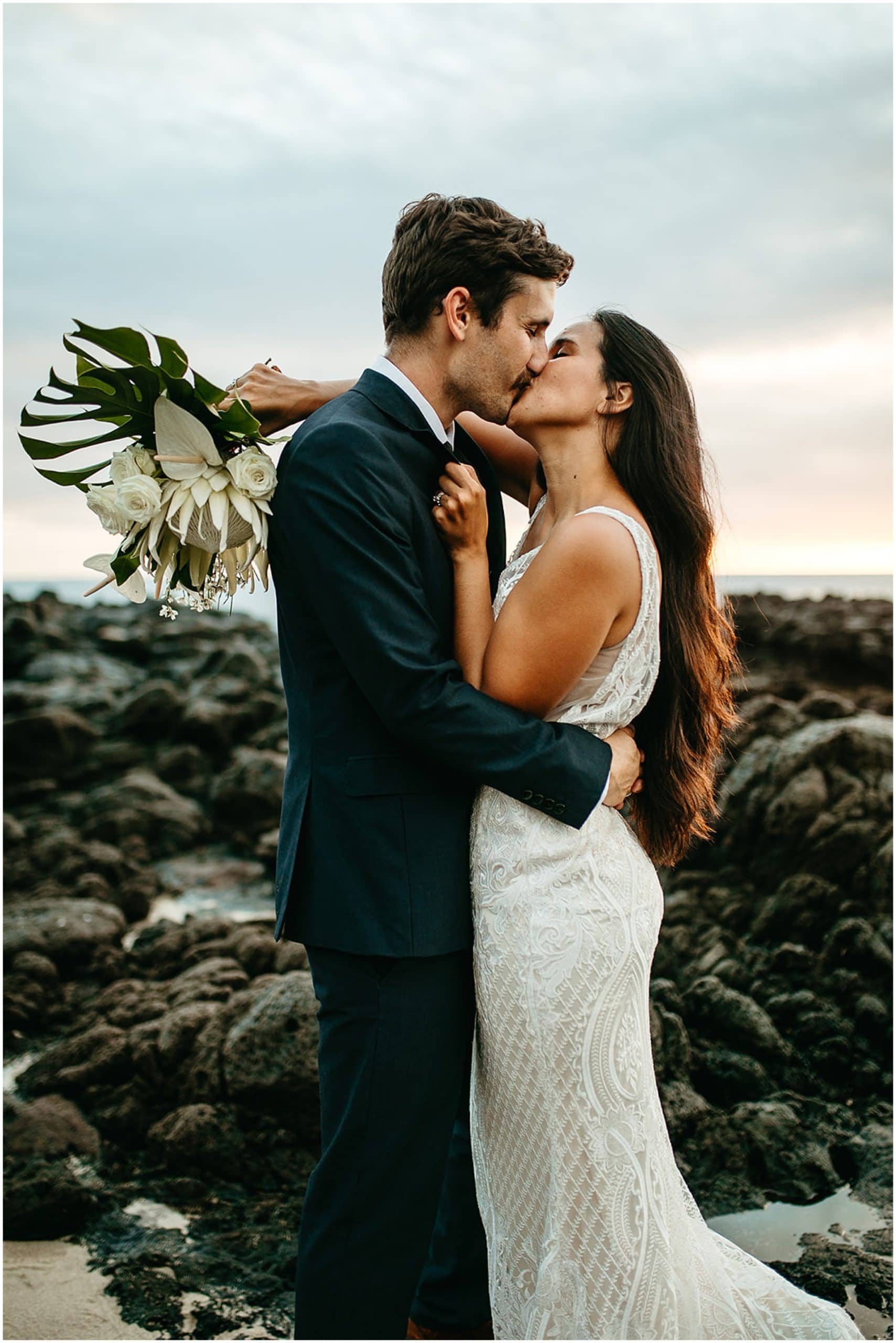 bride holding bouquet and kissing groom