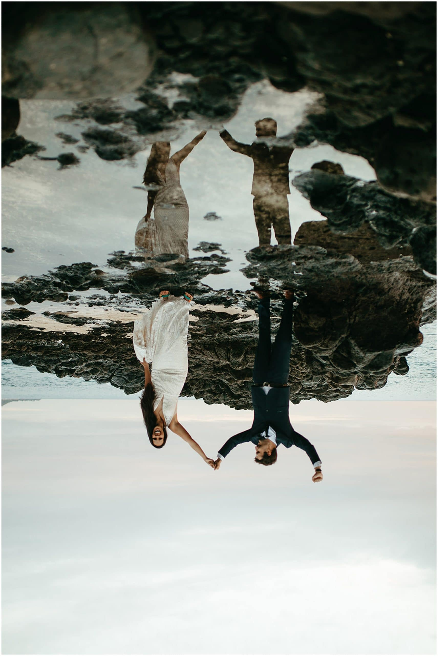 bride and groom reflection in tide pool