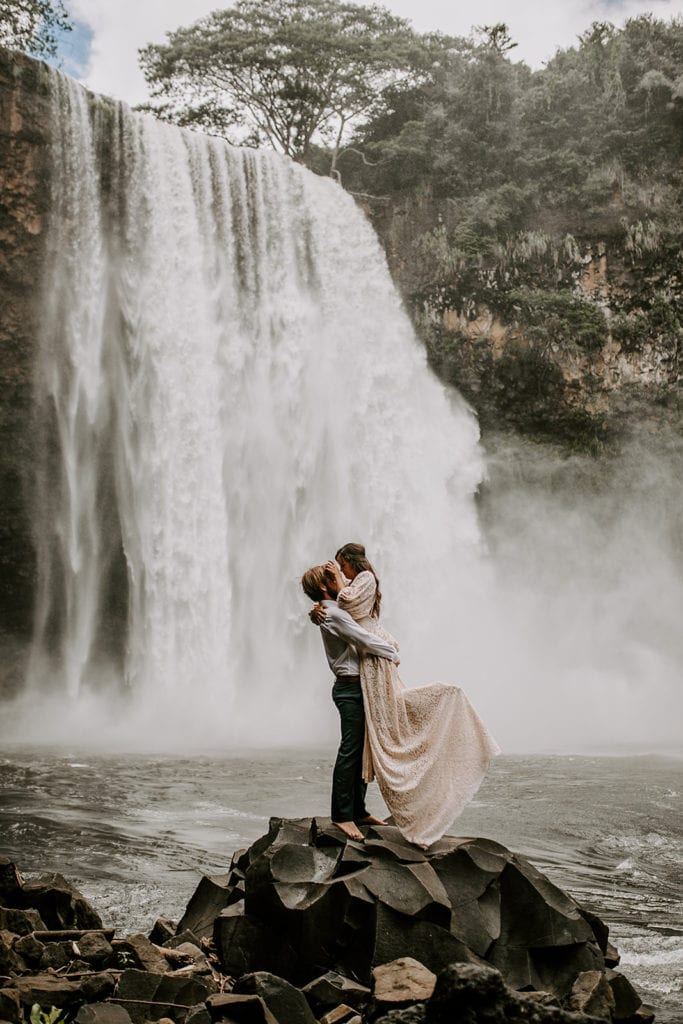 bride and groom getting married at waterfall