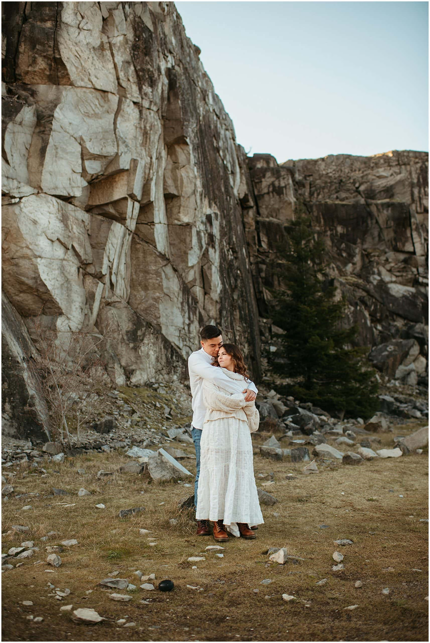 couple standing by rocks