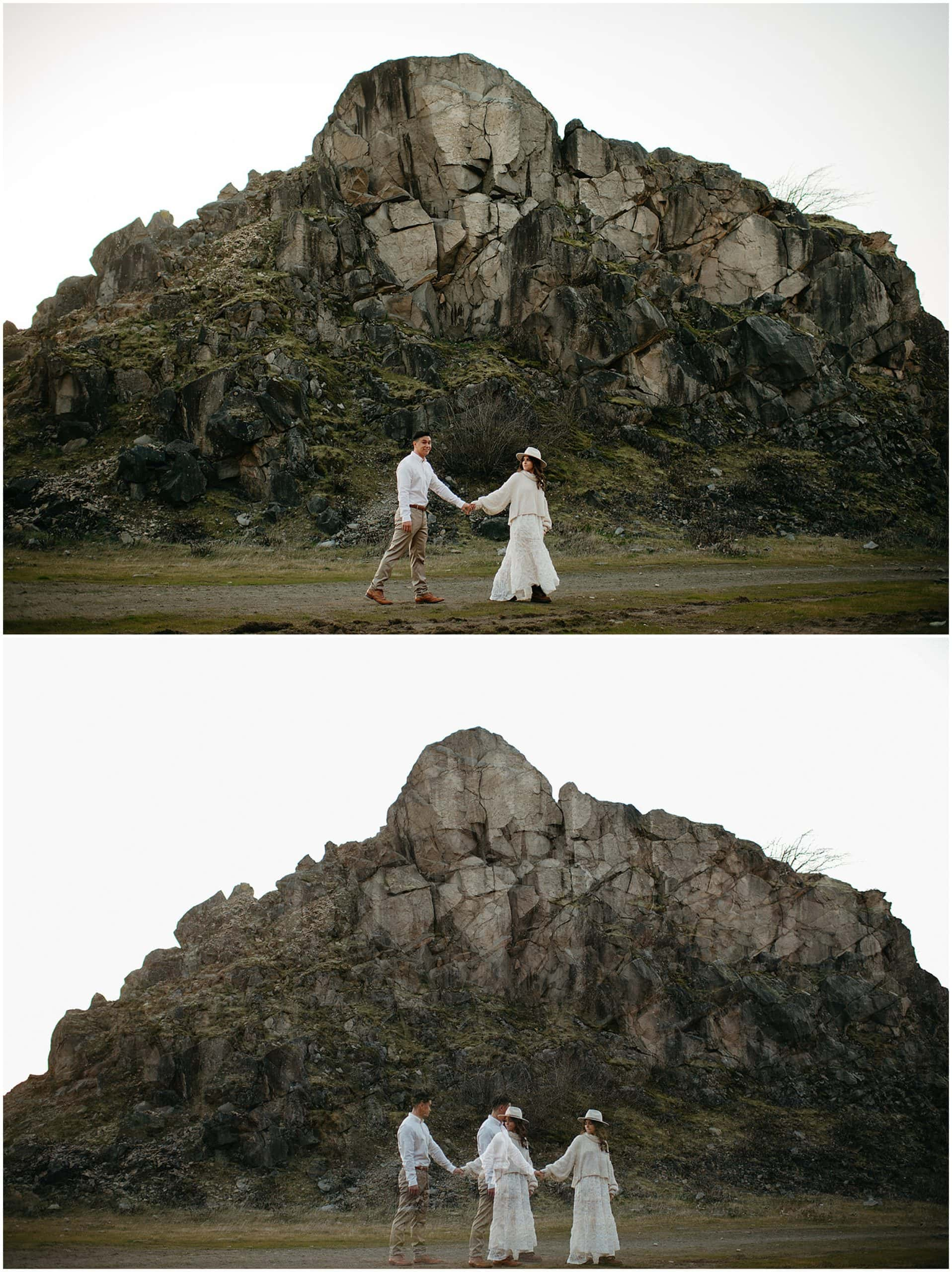 couple walking by rocks