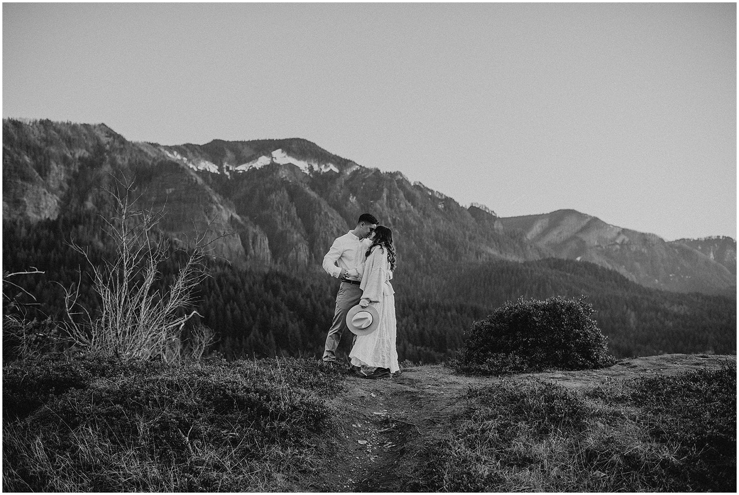 couple kissing on mountain