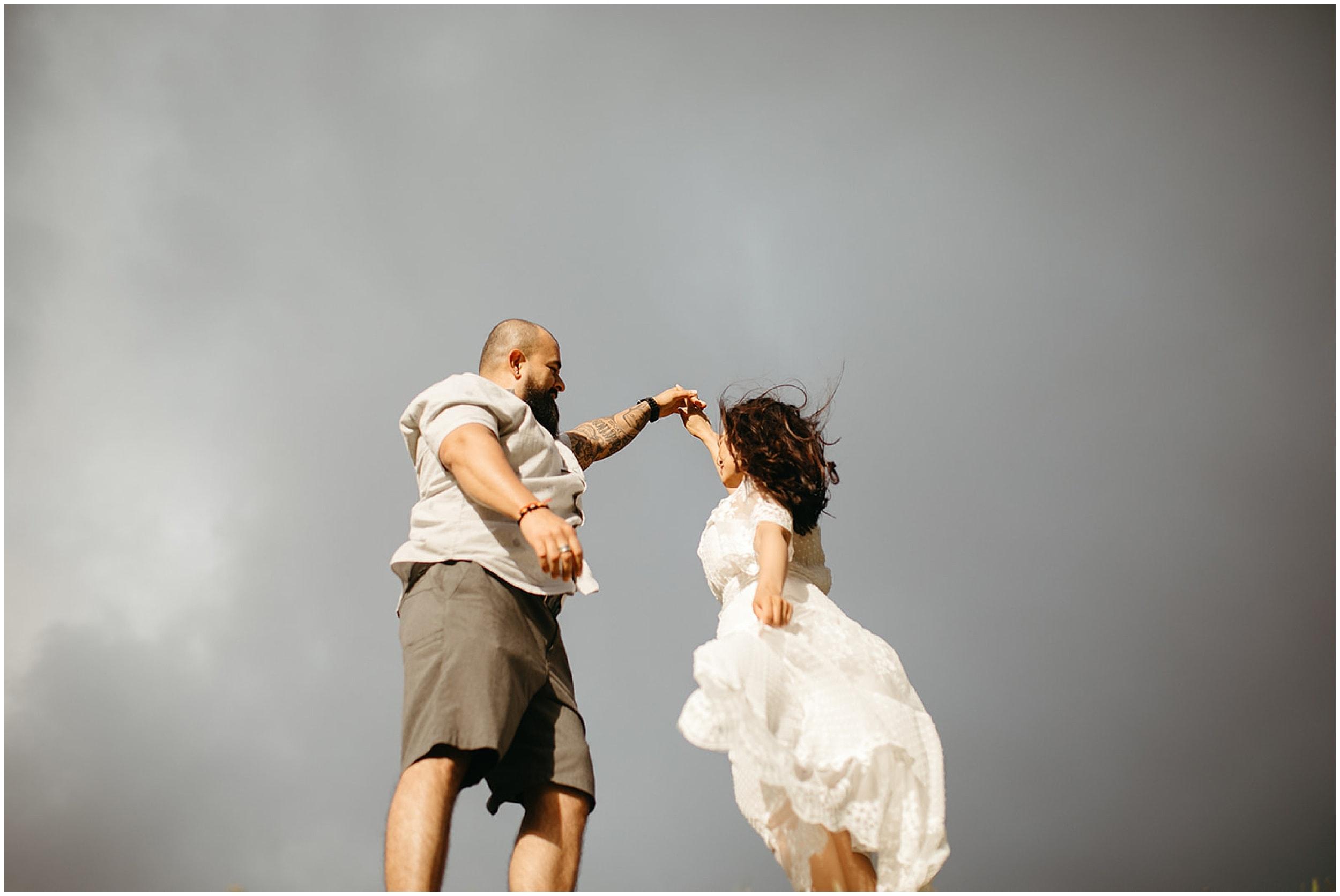 man twirling woman