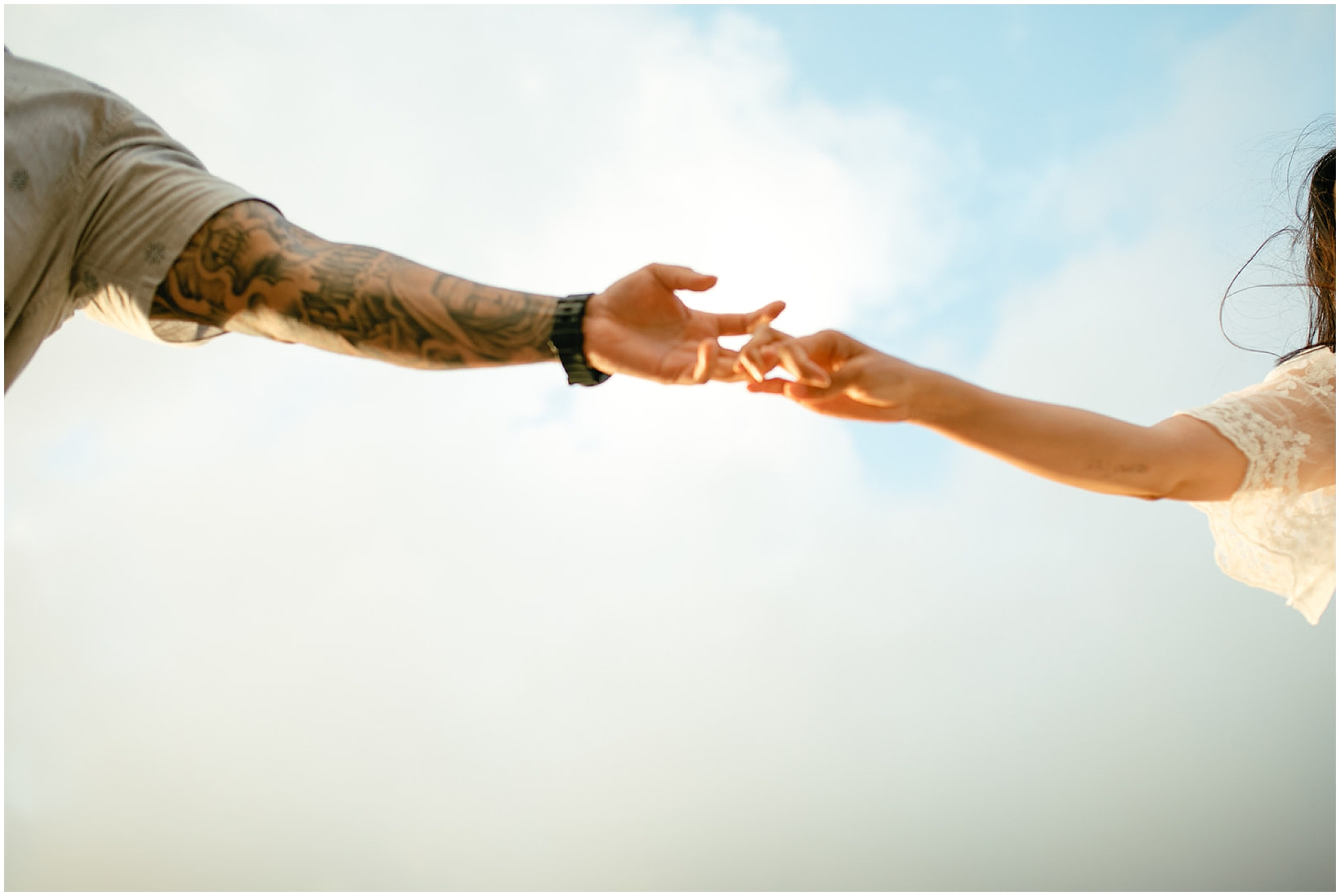 couple holding hands in the air