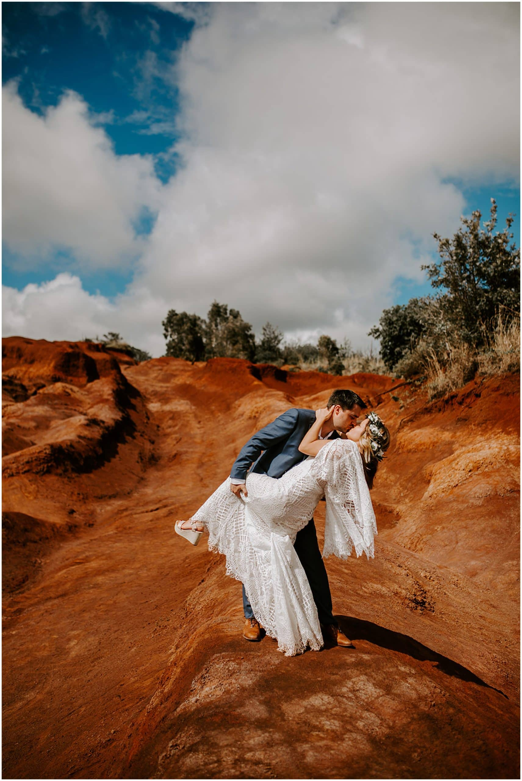 groom dip kissing bride