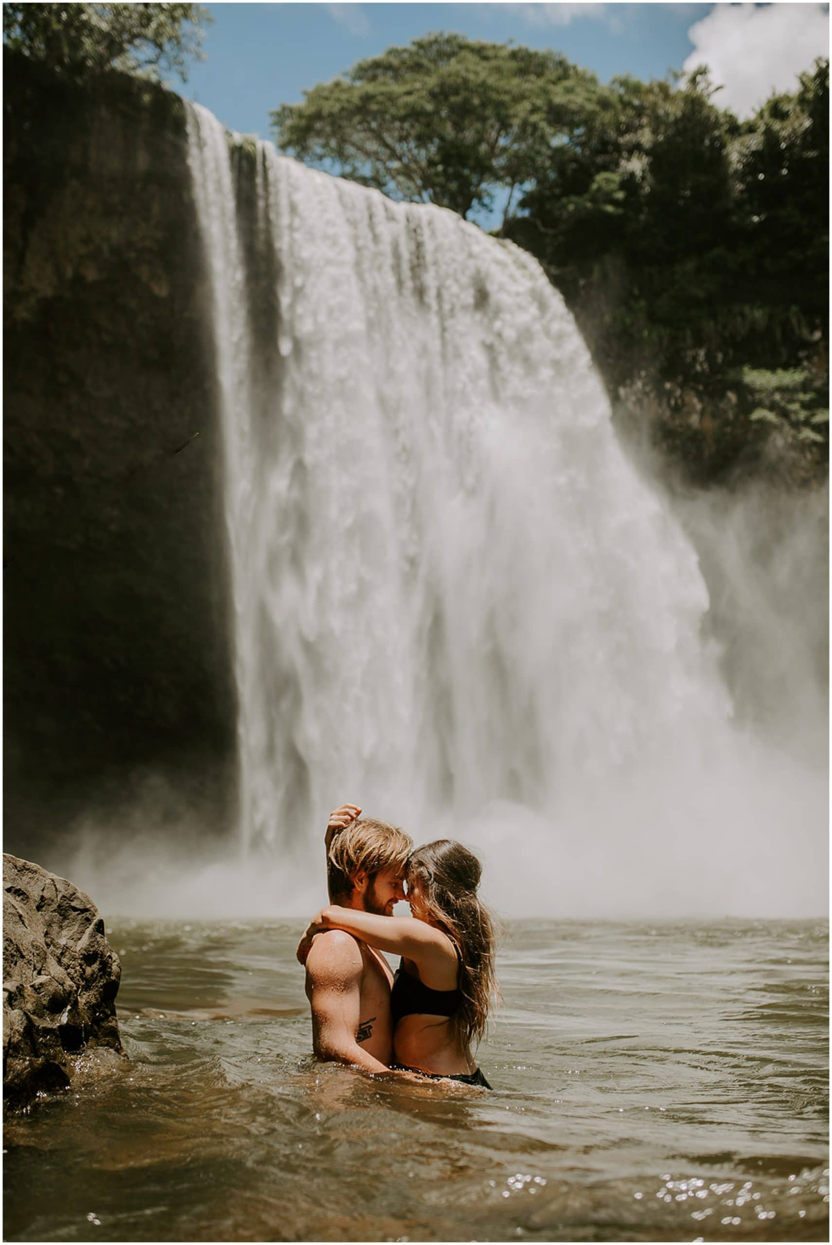 couple kissing in waterfall