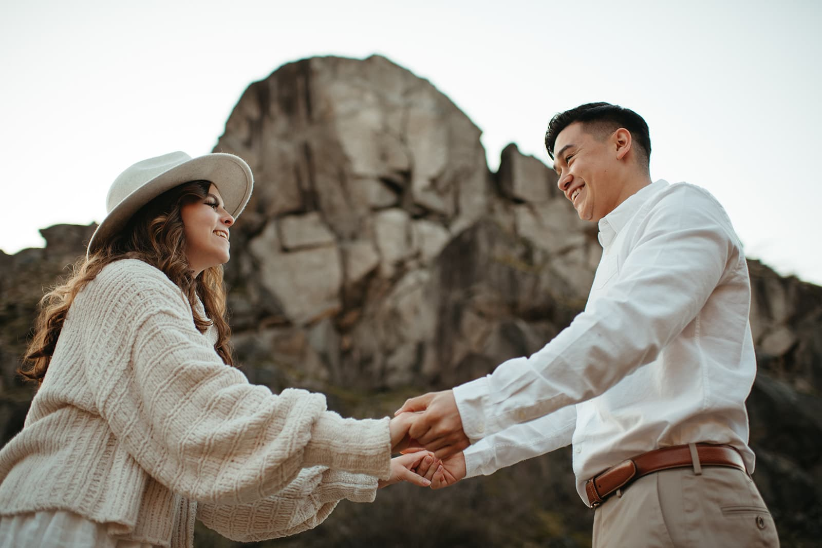 couple holding hands and smiling