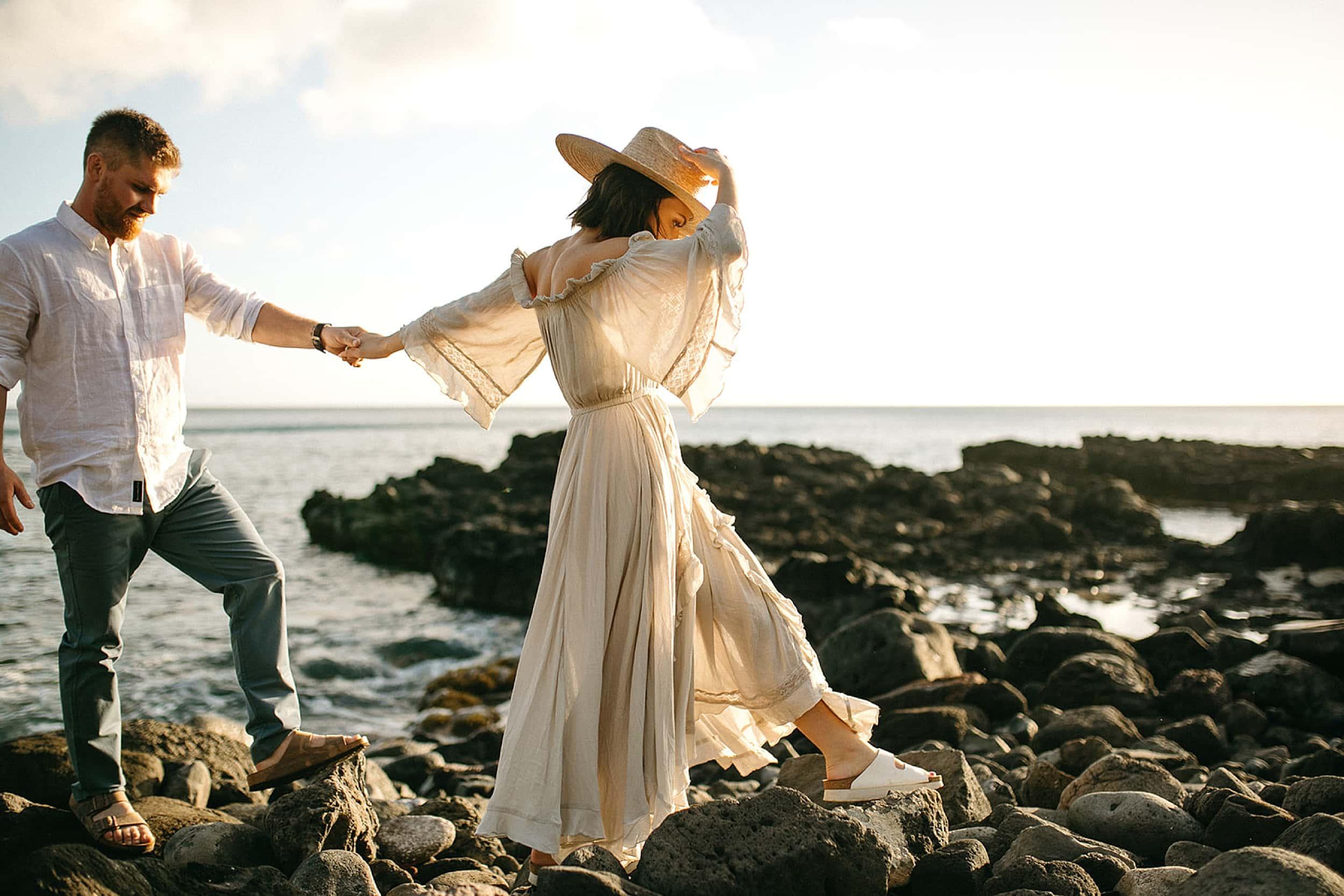 couple walking on beach in Hawaii