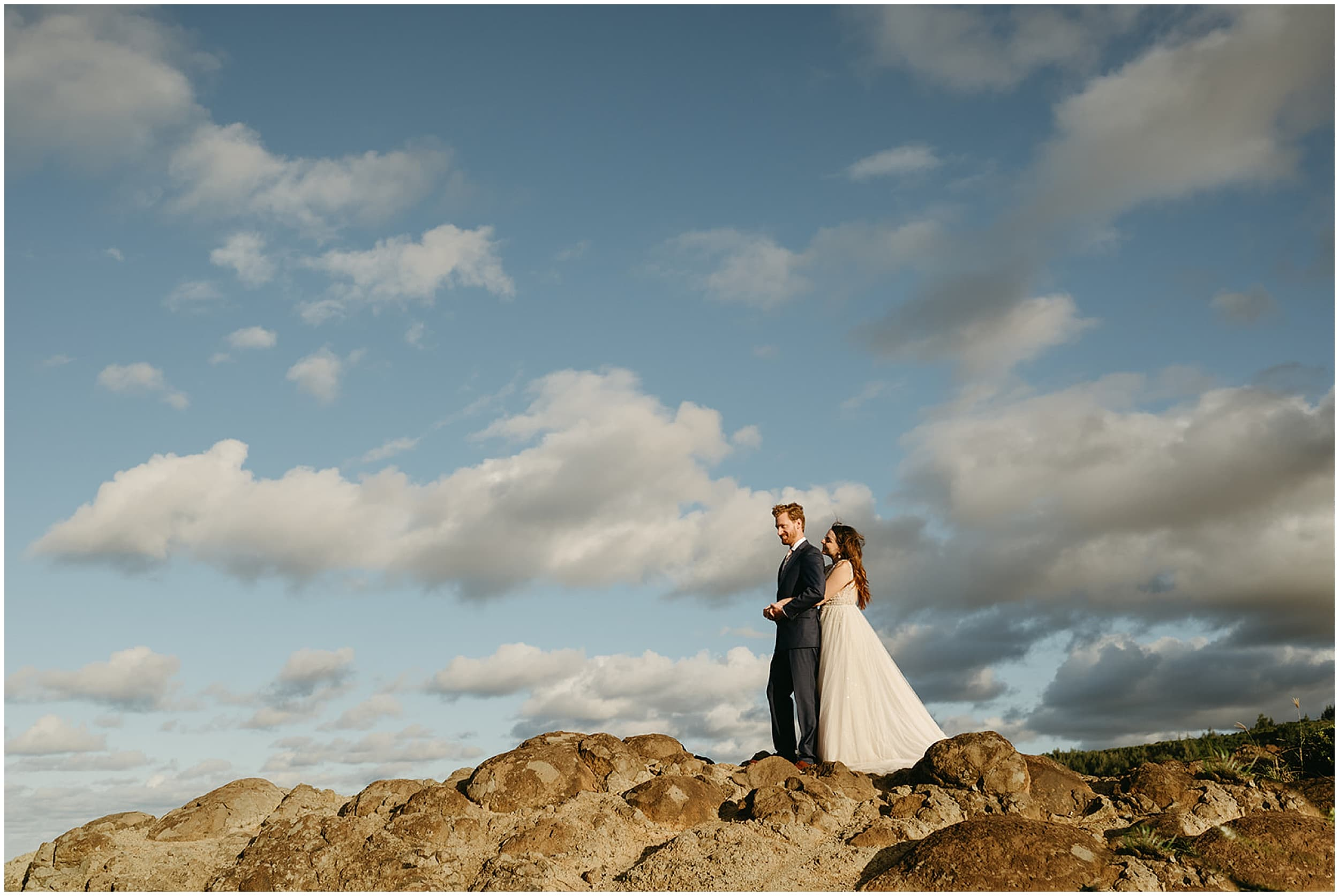 couple standing on cliff
