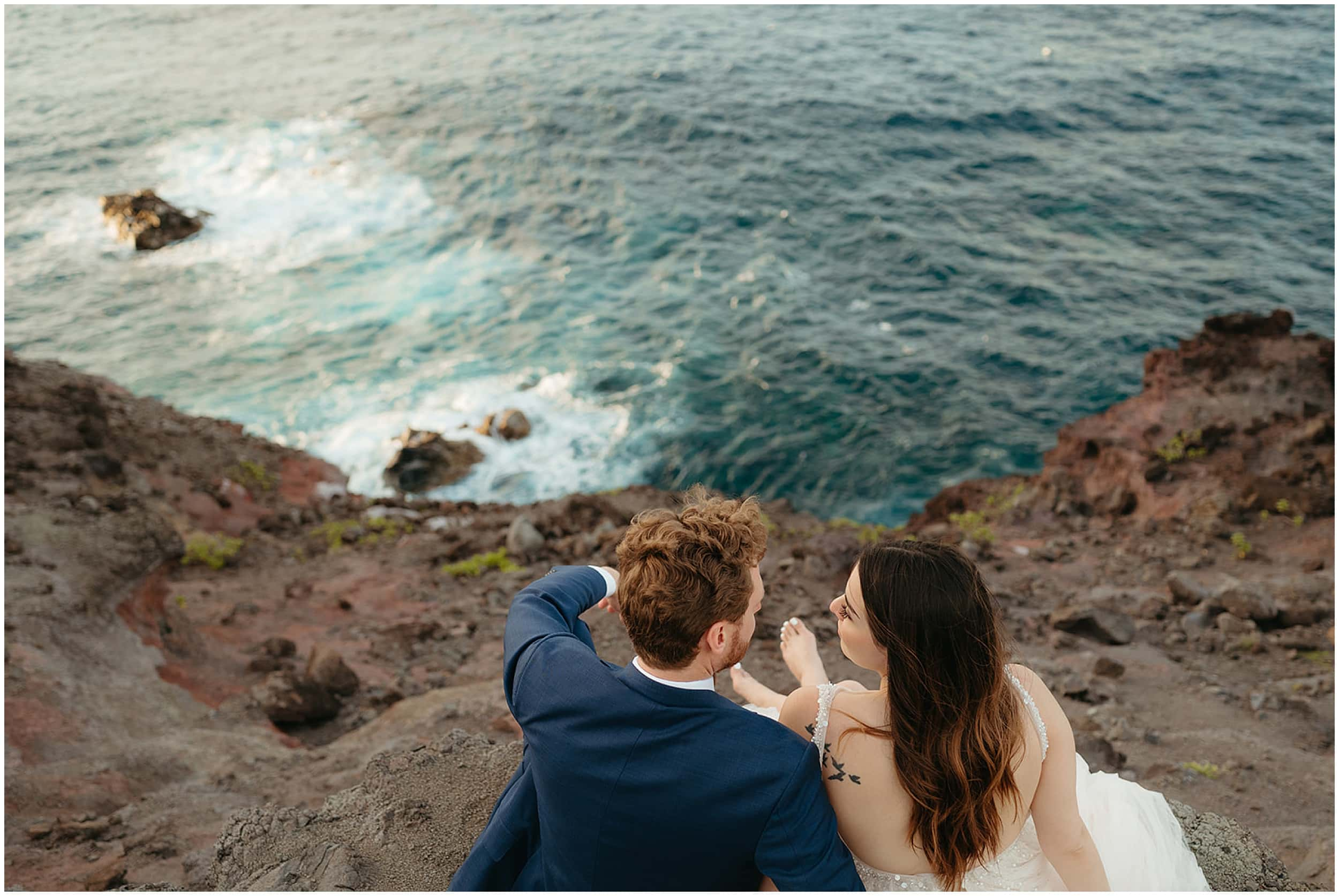 couple sitting by ocean