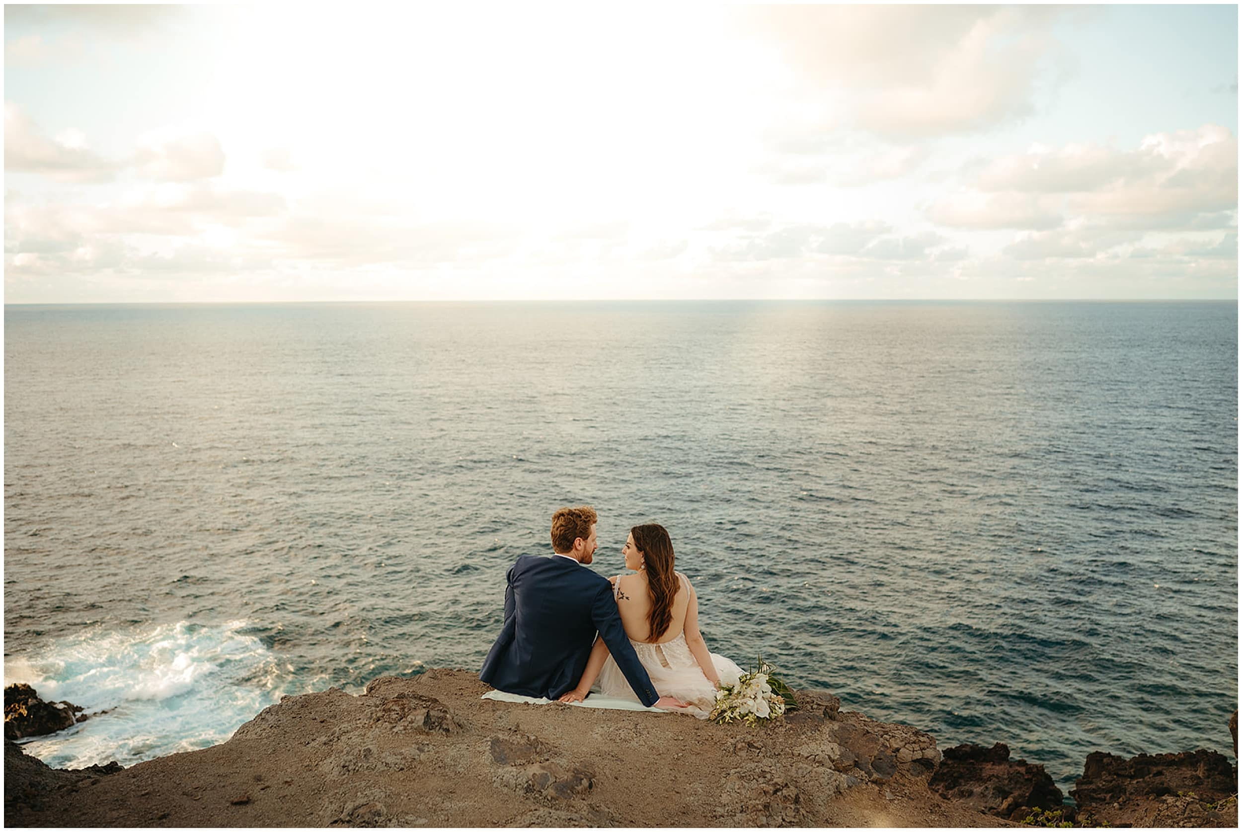 couple sitting by the ocean