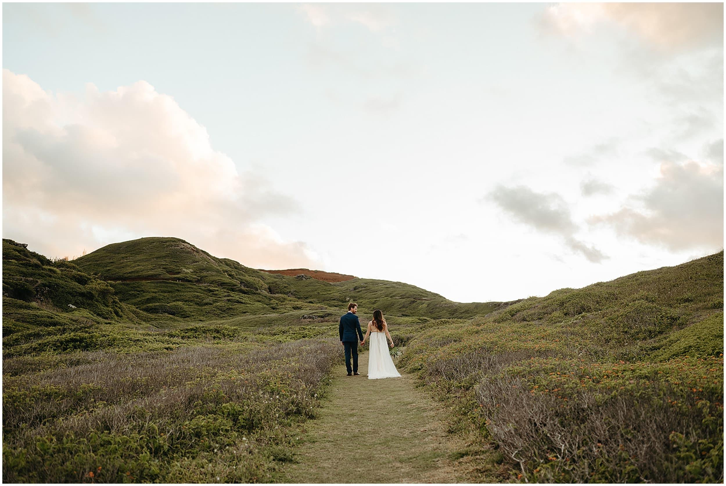 couple walking through mountains