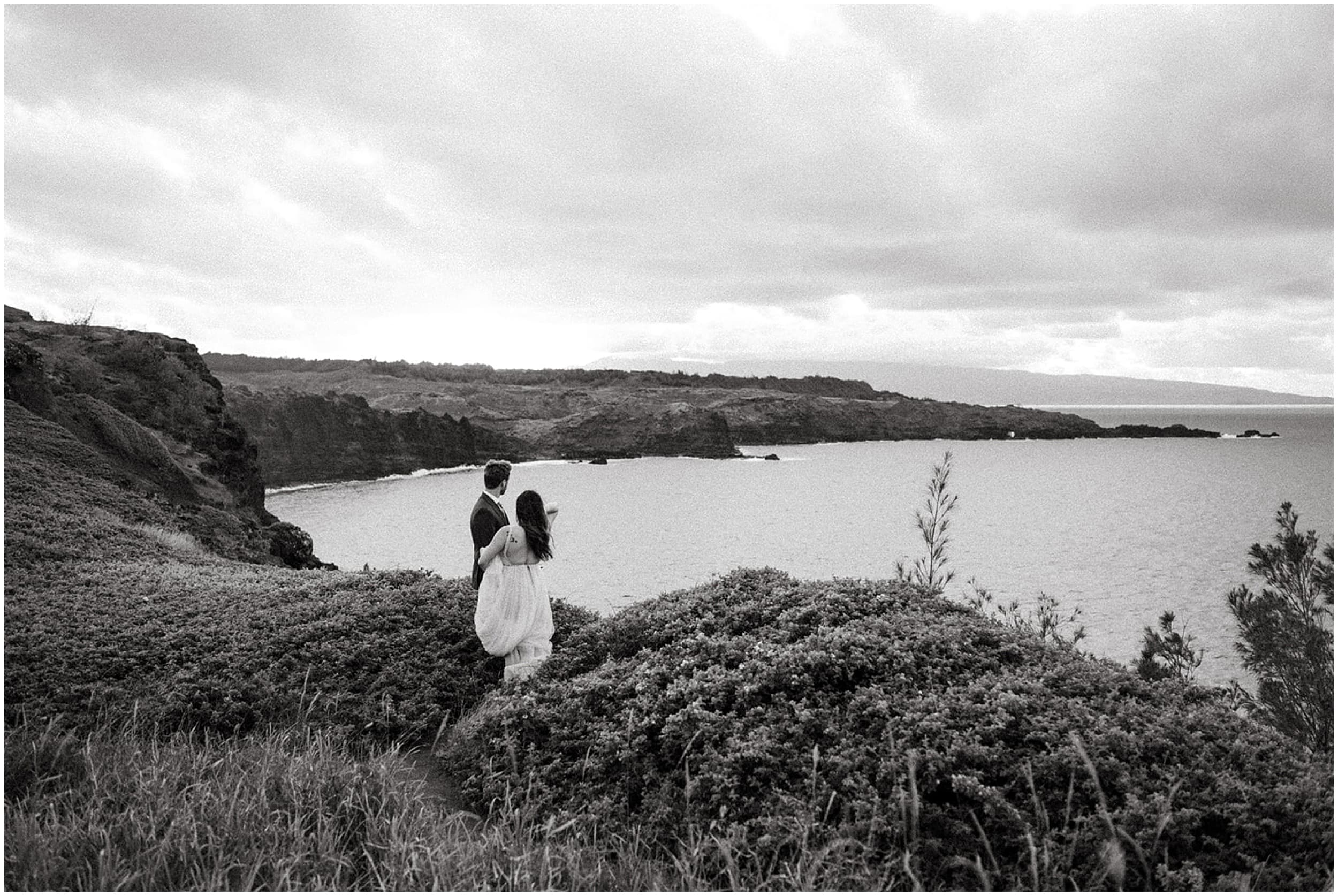 bride and groom looking at view