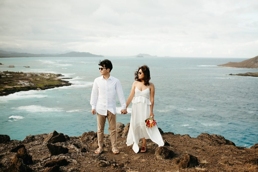 couple standing on cliff edge in Hawaii