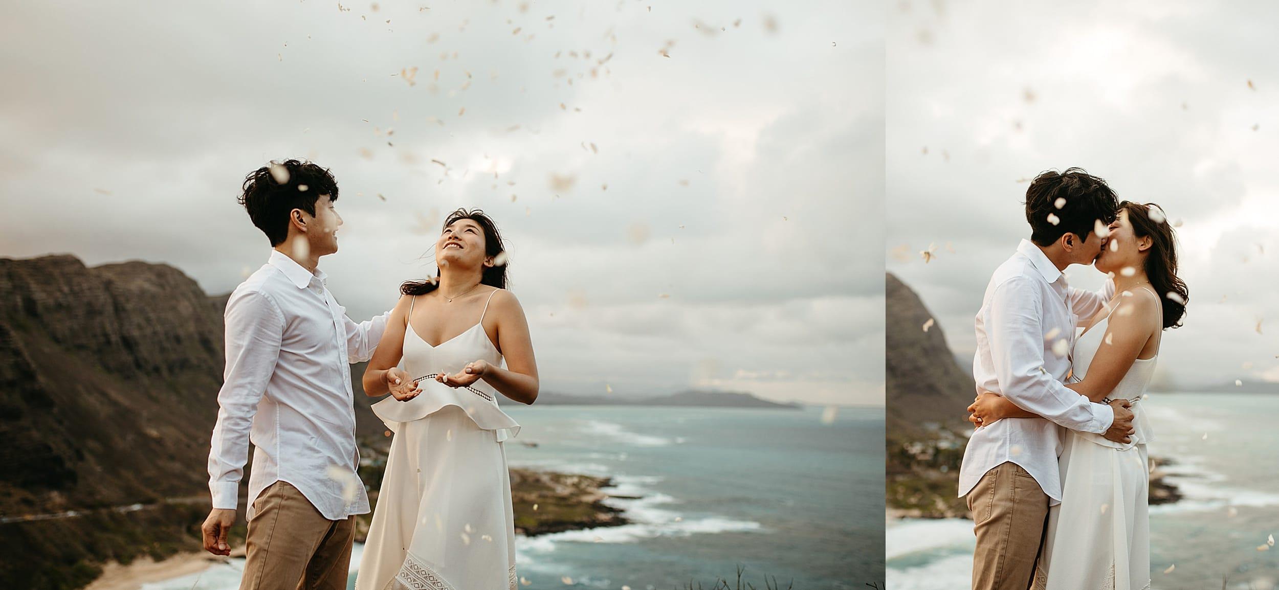 couple throwing rose petals in Oahu