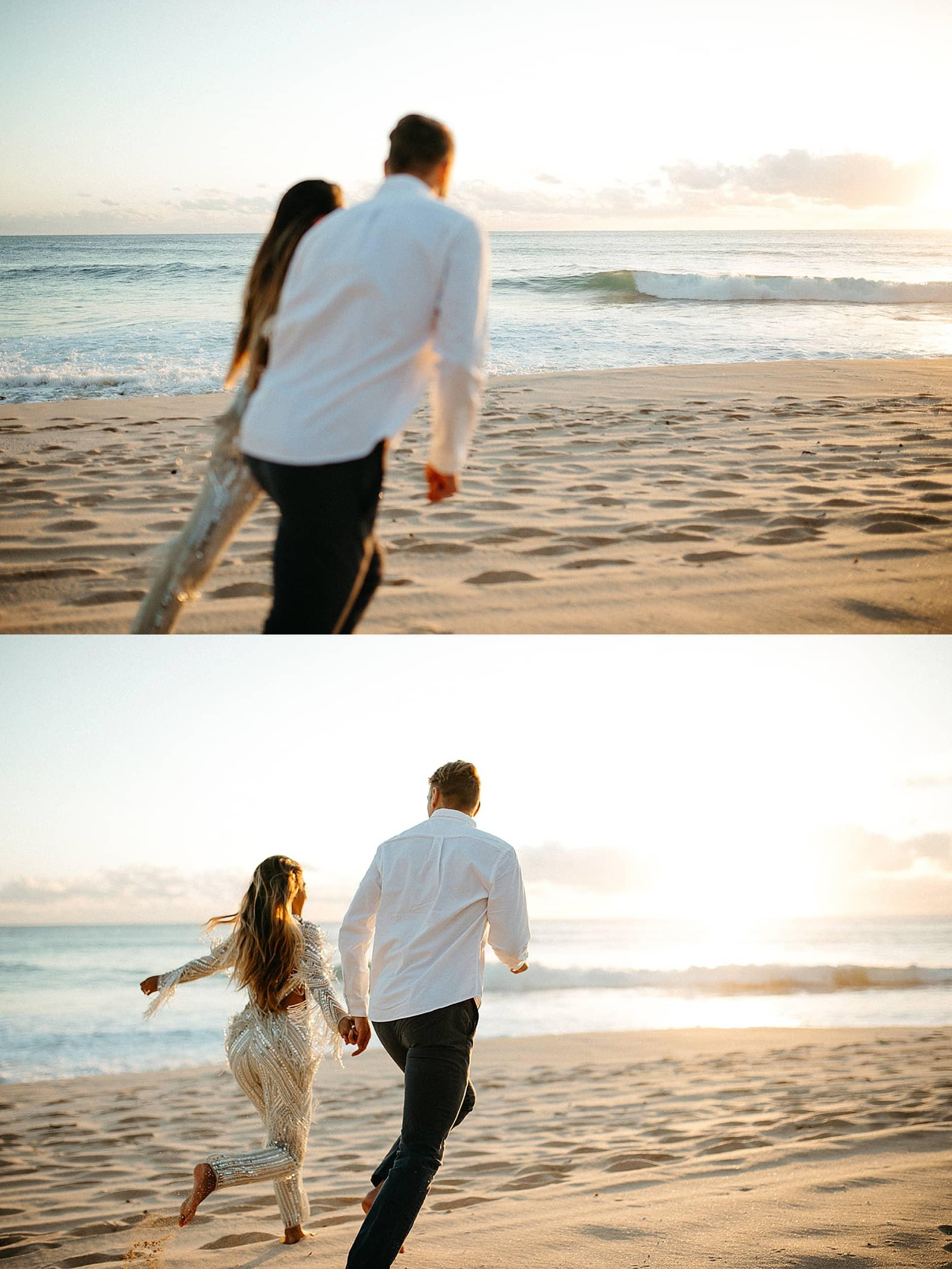 couple walking on a beach in Oahu
