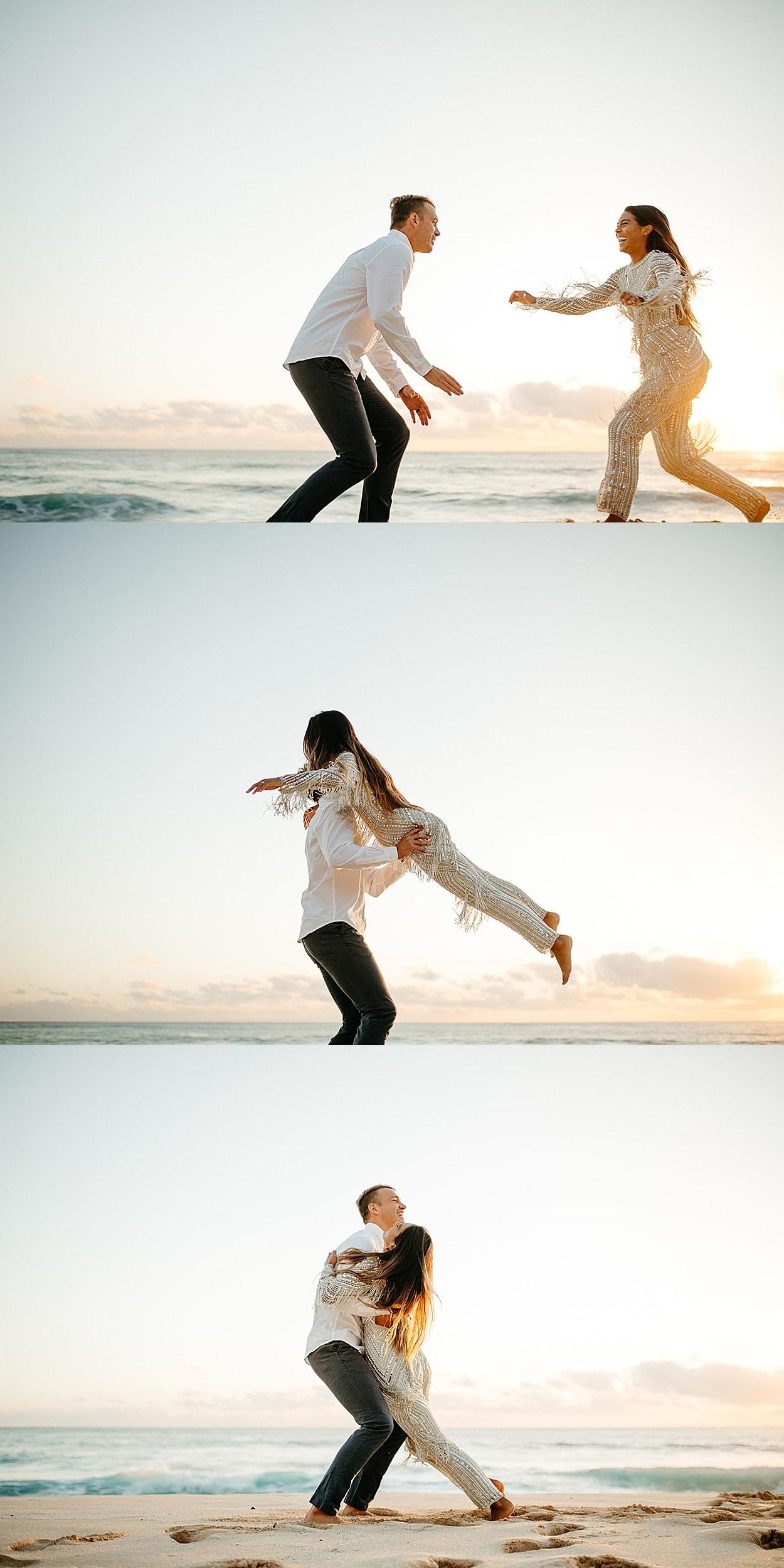 man lifting woman on a beach