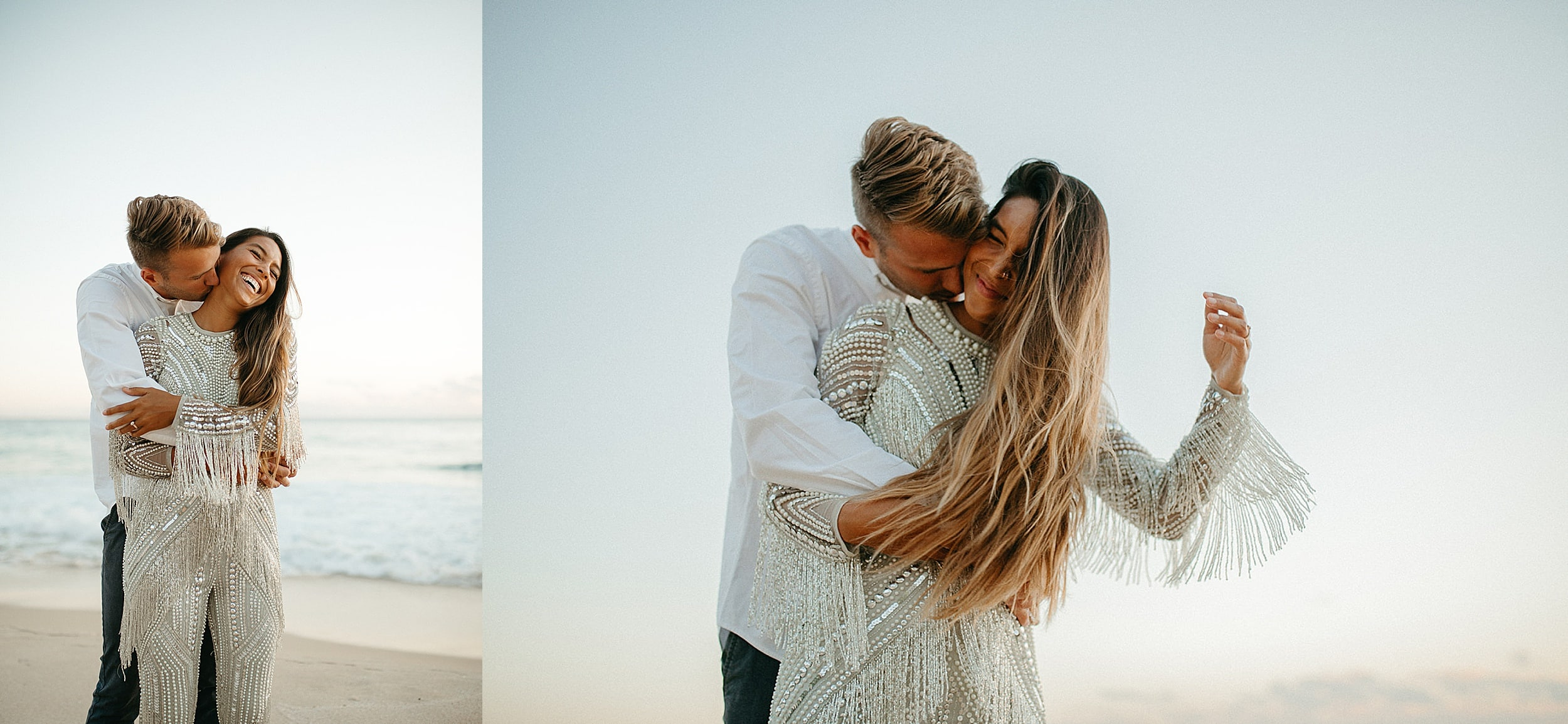 couple embracing on a beach in Oahu
