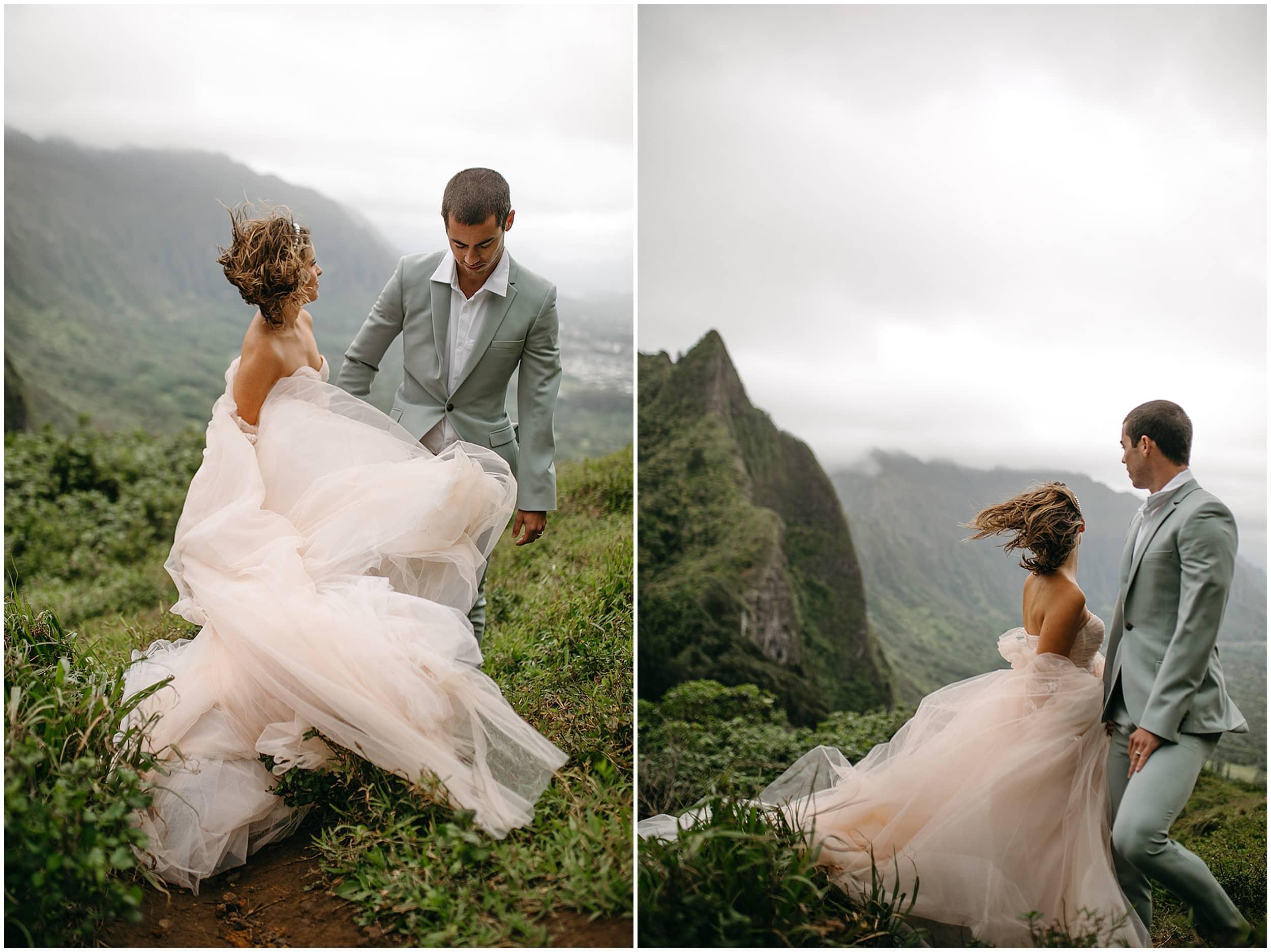 groom leading bride down mountain